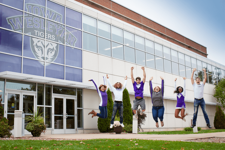 IW students jumping in the air