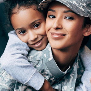 Military parent with child