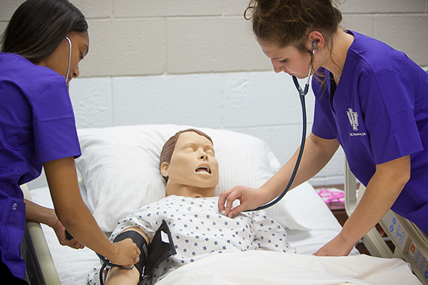 Nursing Students working on a fake person